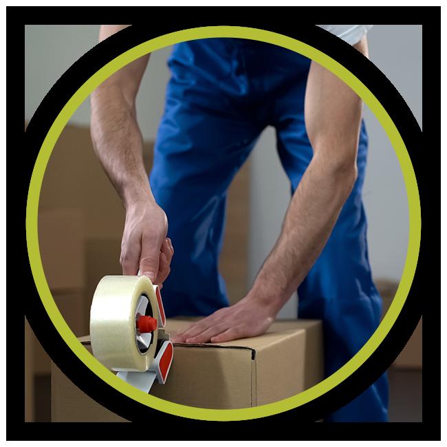 Man taping a moving box shut.