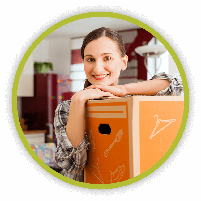 Image of a young woman in her home with a moving box.