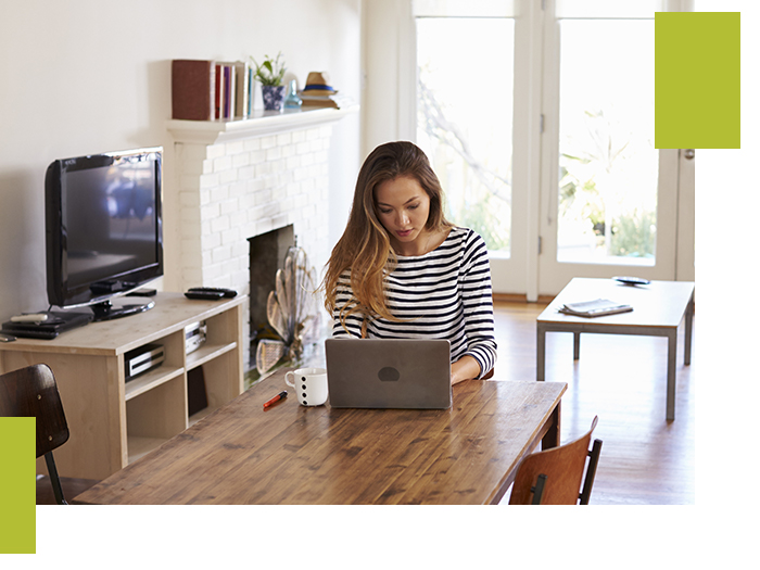 Image of a woman searching on her computer.